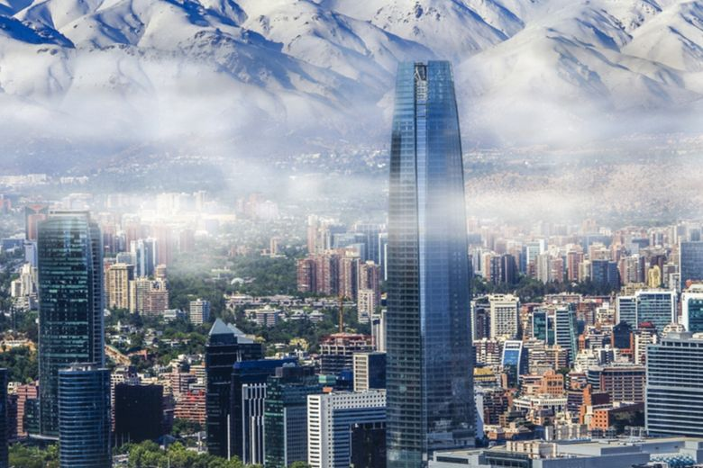 Chile flag and cityscape of Santiago