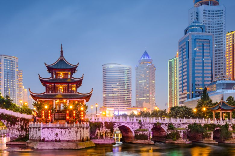 Shanghai skyline, China and national flag