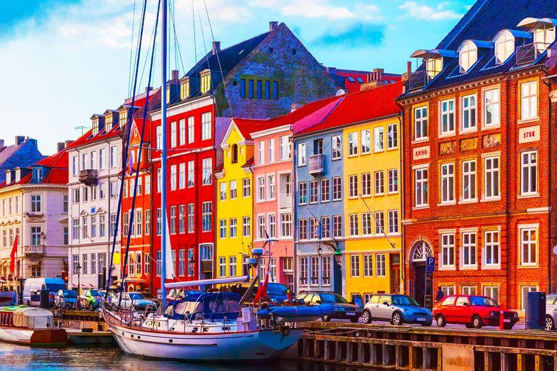 Nyhavn in Copenhagen, Denmark and national flag