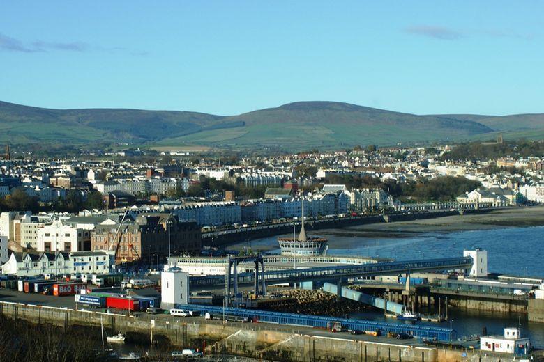 Douglas Lighthouse on the Isle of Man and flag