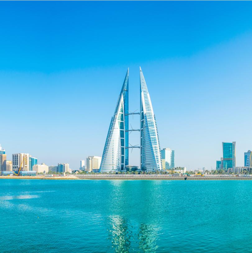 Skyline of Bahrain's capital city and national flag