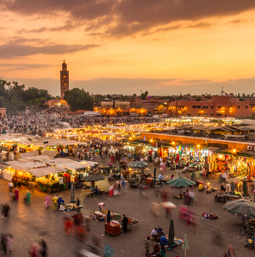 The city of Marrakesh and the Moroccan flag