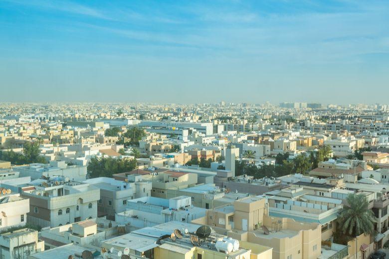 The Saudi Arabian national flag and the city of Riyadh