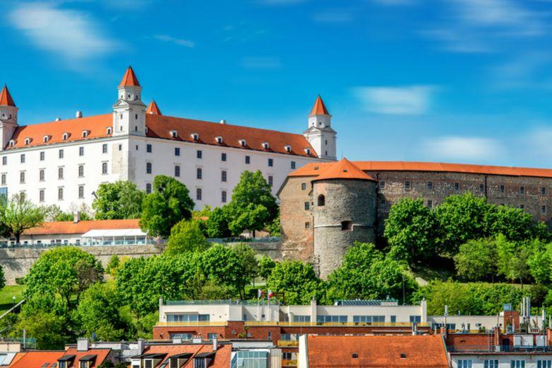 Slovakia's national flag and Bratislava castle