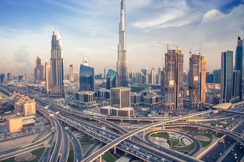 UAE's national flag and the skyline of the city of Dubai