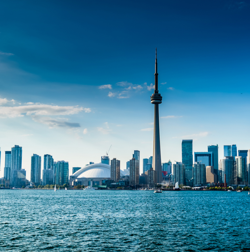 Skyline of Toronto city in Canada and national flag