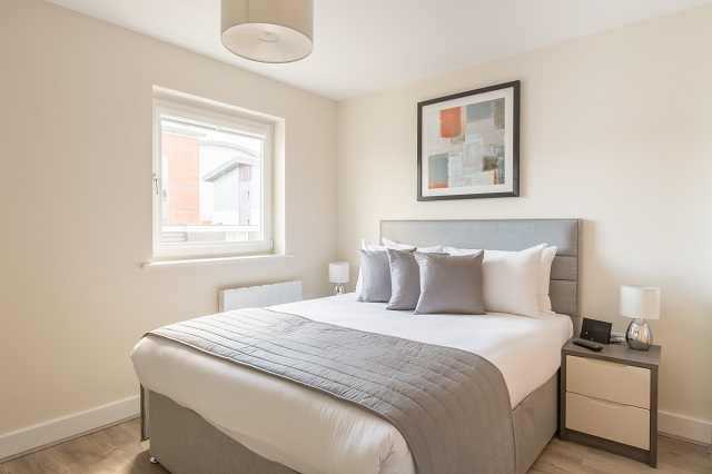 Bright bedroom at Solstice House Apartments