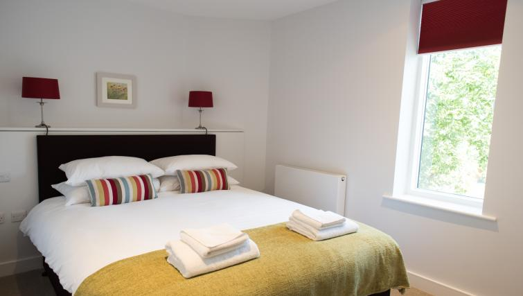 Comfortable bedroom at Jubilee House Apartments