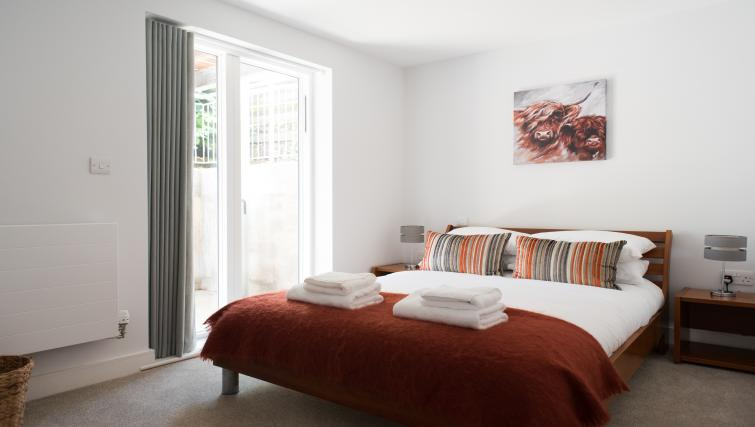 Bed at Jubilee House Apartments
