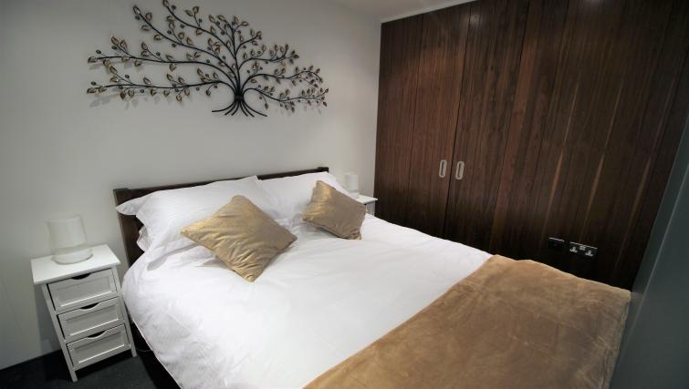 Bed at Harbourside Apartment