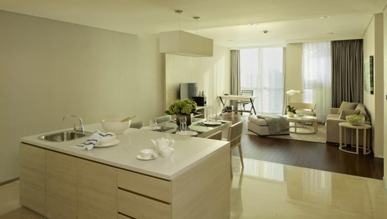 Kitchen and dining area at Fraser Residence Menteng Jakarta