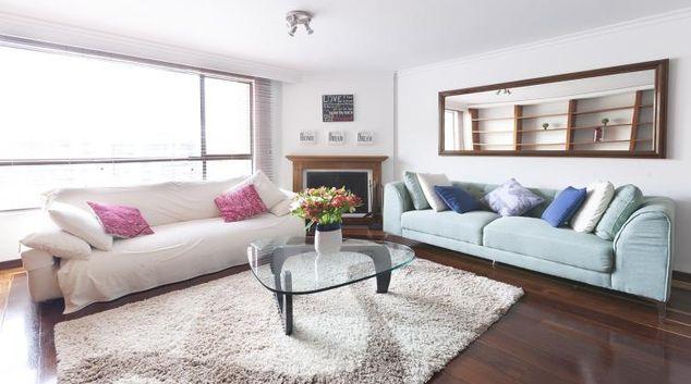 Living room at the Duplex Wood Apartment