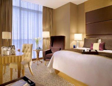 Executive bedroom in Premier Cozmo Apartments