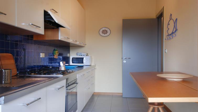 Fully equipped kitchen at Domenichino Apartment