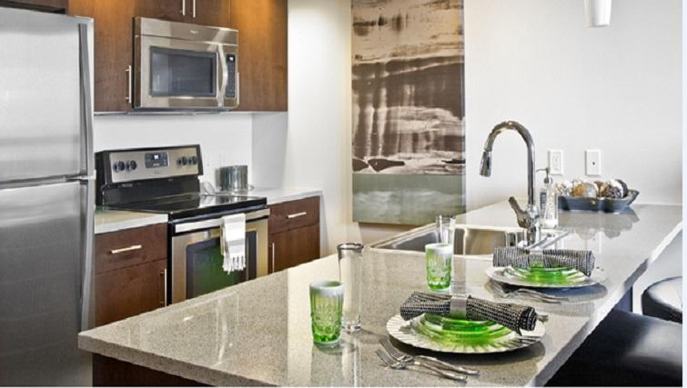 Fully equipped kitchen at Coppins Well Seattle Apartments
