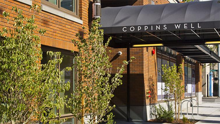 Entrance of Coppins Well Seattle Apartments
