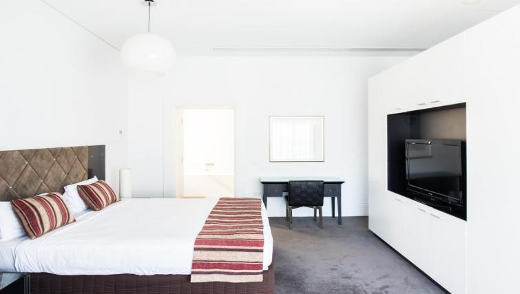 Spacious bedroom at Seasons Heritage Melbourne Apartments