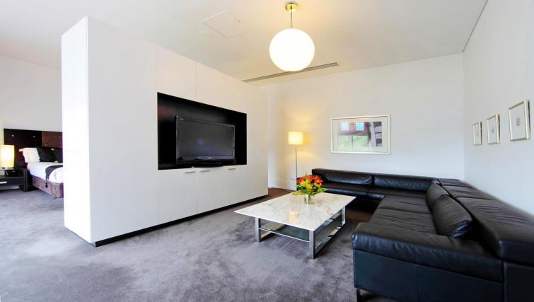 Slick living area at Seasons Heritage Melbourne Apartments