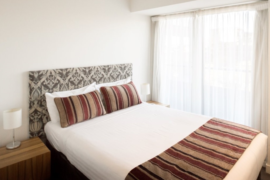 Double bed at Seasons Heritage Melbourne Apartments