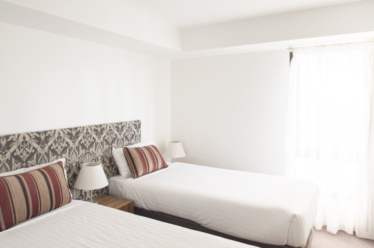 Twin beds at Seasons Heritage Melbourne Apartments
