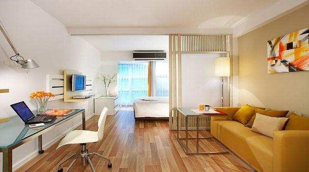 Open plan living area in Citadines Sukhumvit 16 Apartments