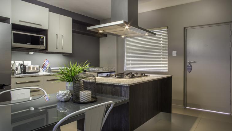 Equipped kitchen at Bryanston Drive Apartments