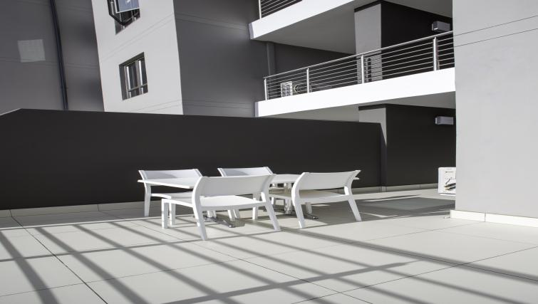 Outdoor lounge area at Bryanston Drive Apartments