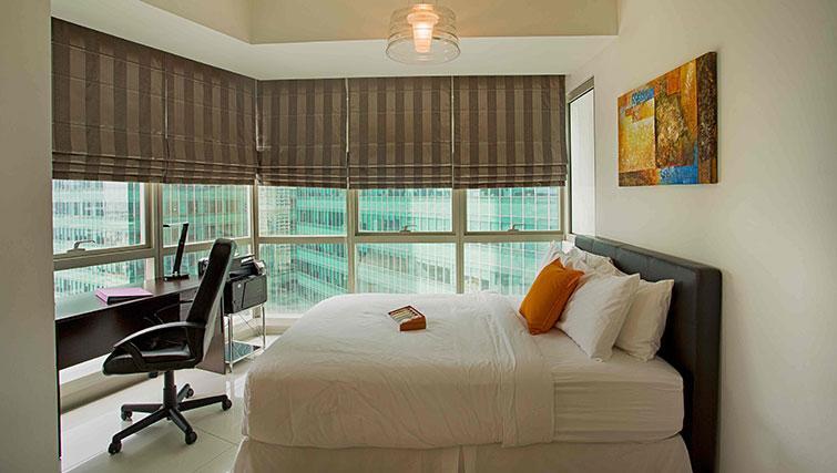 Comfortable bedroom at Marina Boulevard Singapore Apartments