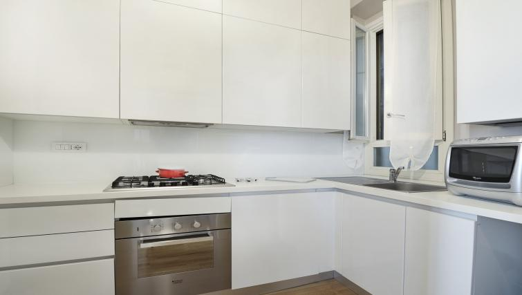 Equipped kitchen at San Rocco Apartment