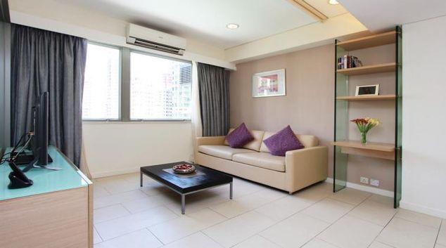 Simplistic living area at Wan Chai Apartments