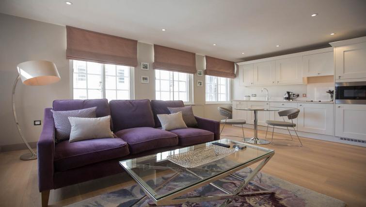 Purple sofa at the Waterloo Street Apartments