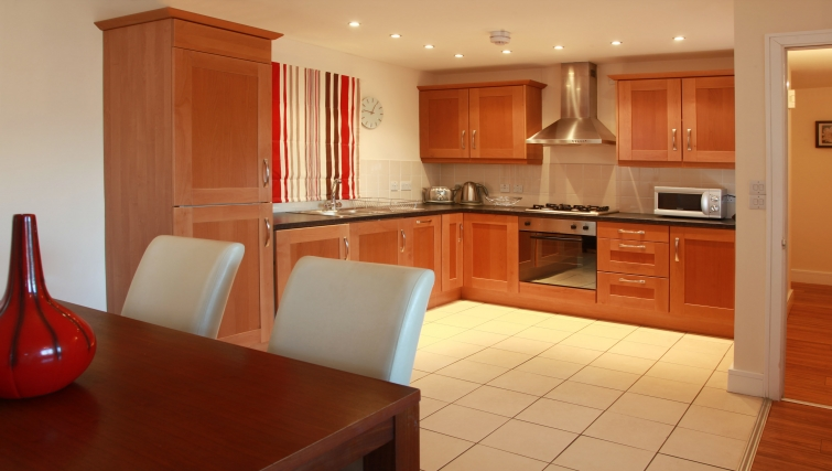 Large well lit kitchen in Cordia Serviced Apartments