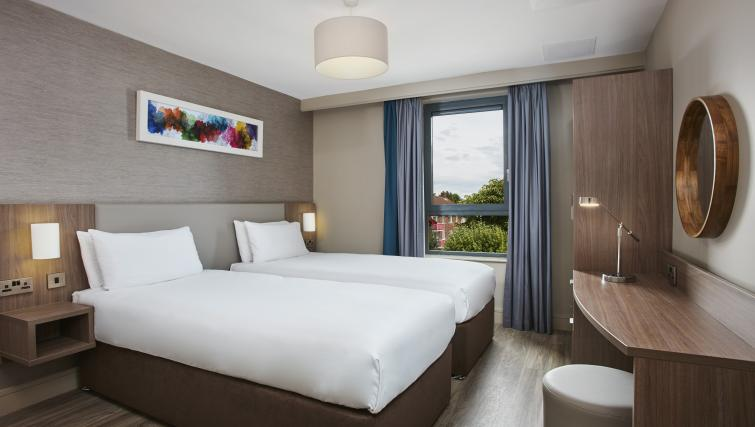 Twin beds at Cordia Serviced Apartments