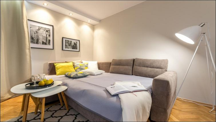 Sofa bed at Chmielna Apartment