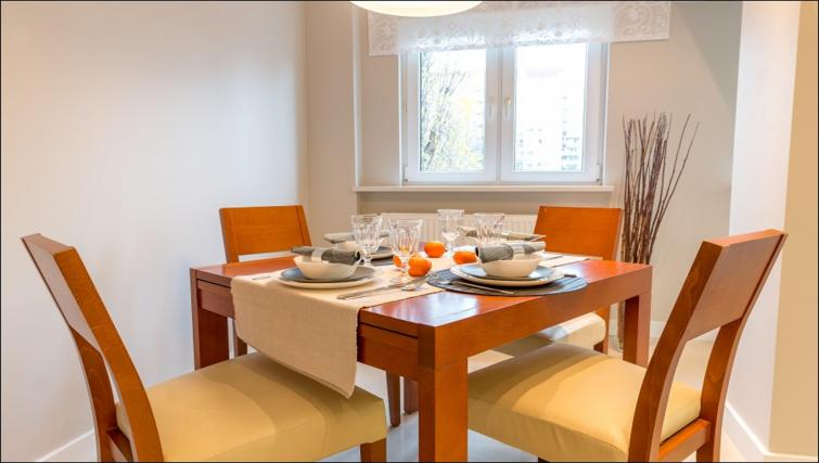 Dining table at Chmielna Apartment
