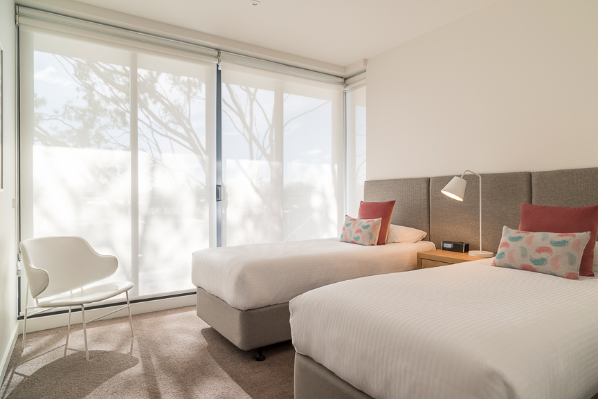 Twin beds at Sandy Hill Apartments