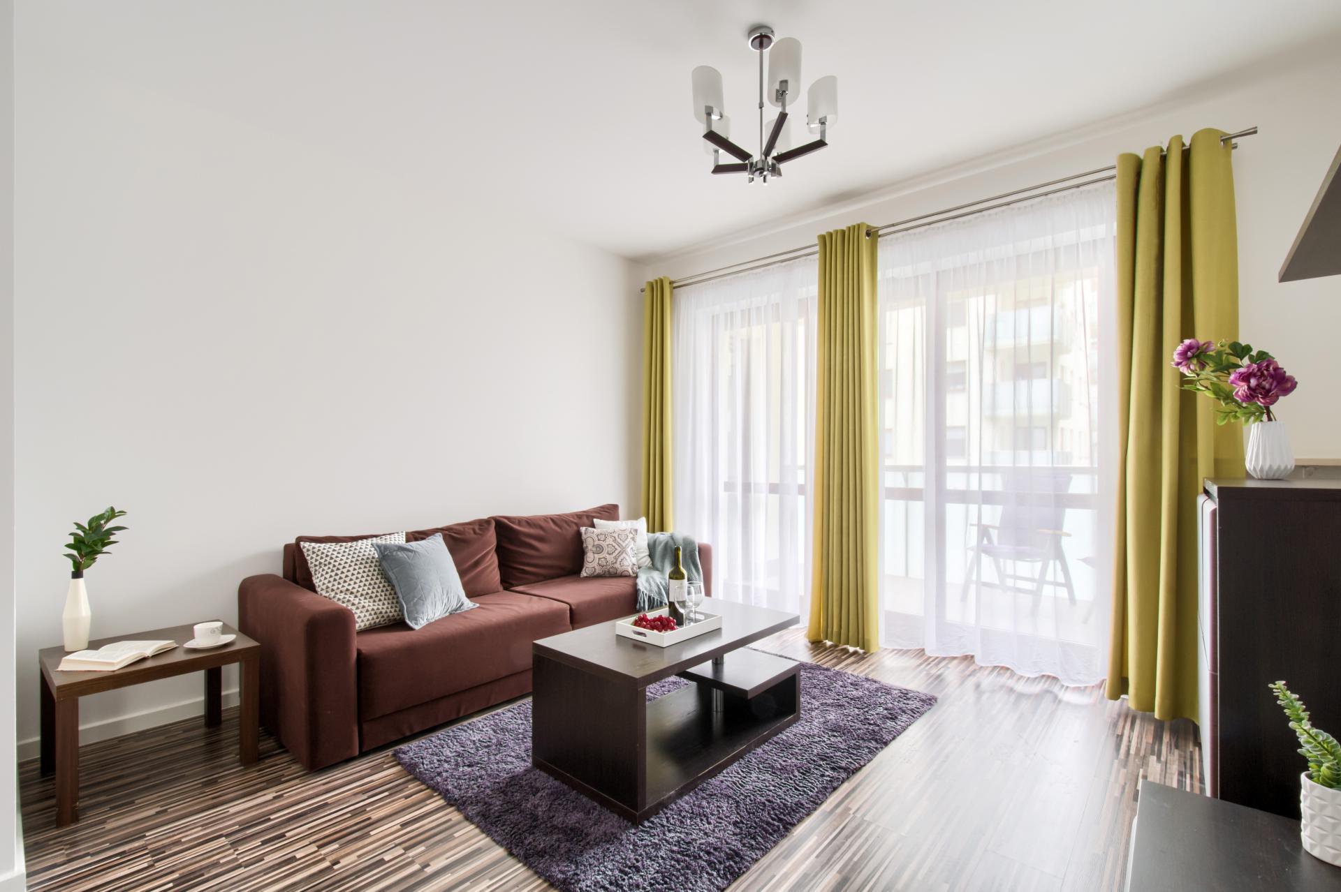 Sofa at Gieldowa Apartment