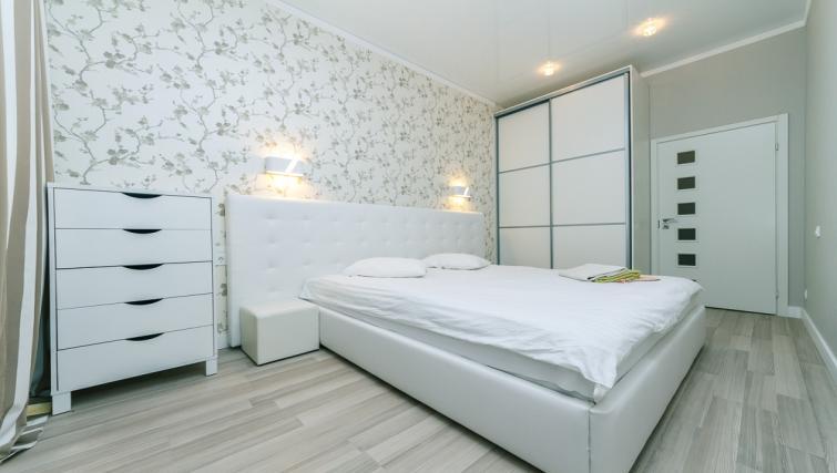 Bed at Darvina Apartment