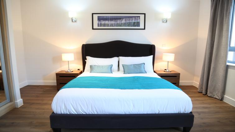 Bed at Aldgate City Apartments