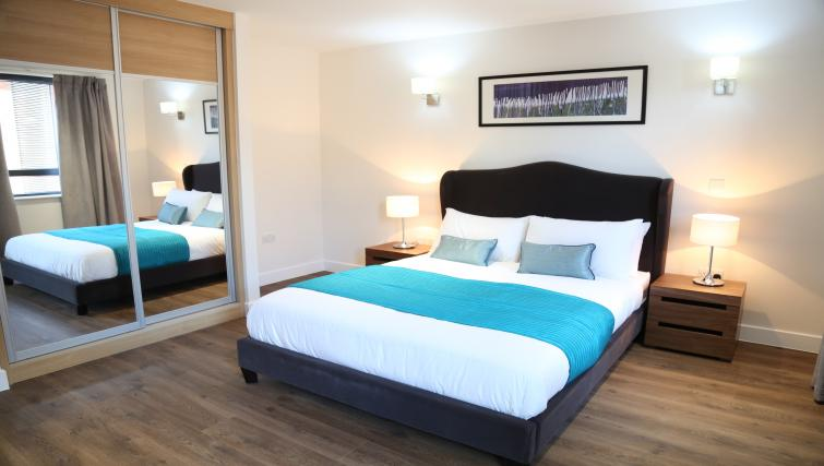 Double bed at Aldgate City Apartments