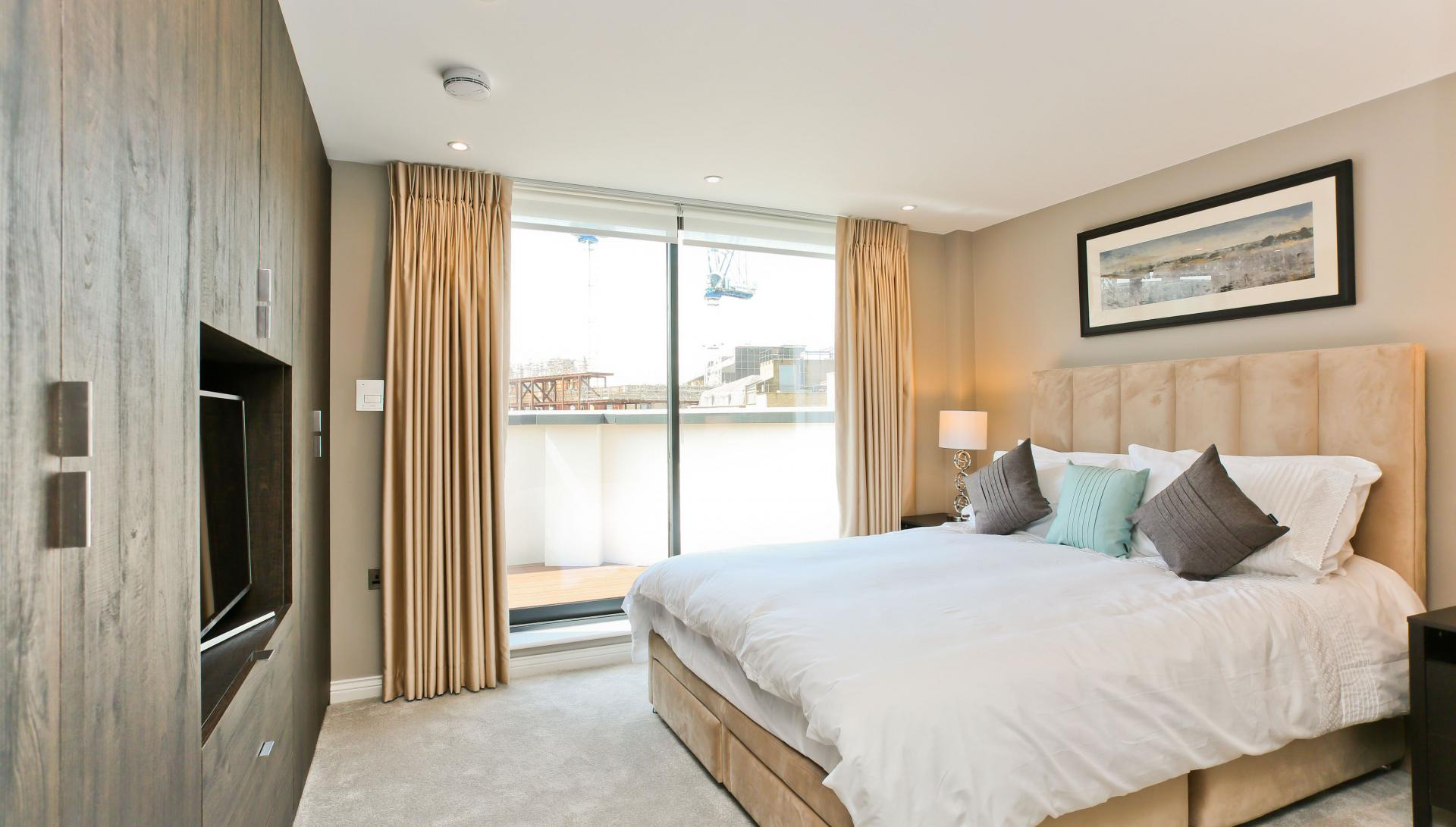 Bright bedroom at Buckingham Gate Apartments