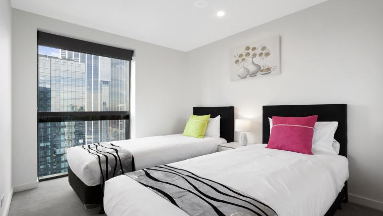 Twin beds at Platinum City Serviced Apartments