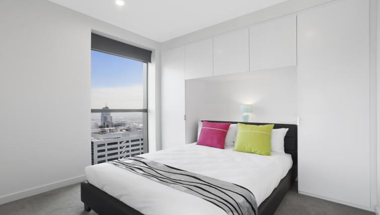Bright bedroom at Platinum City Serviced Apartments