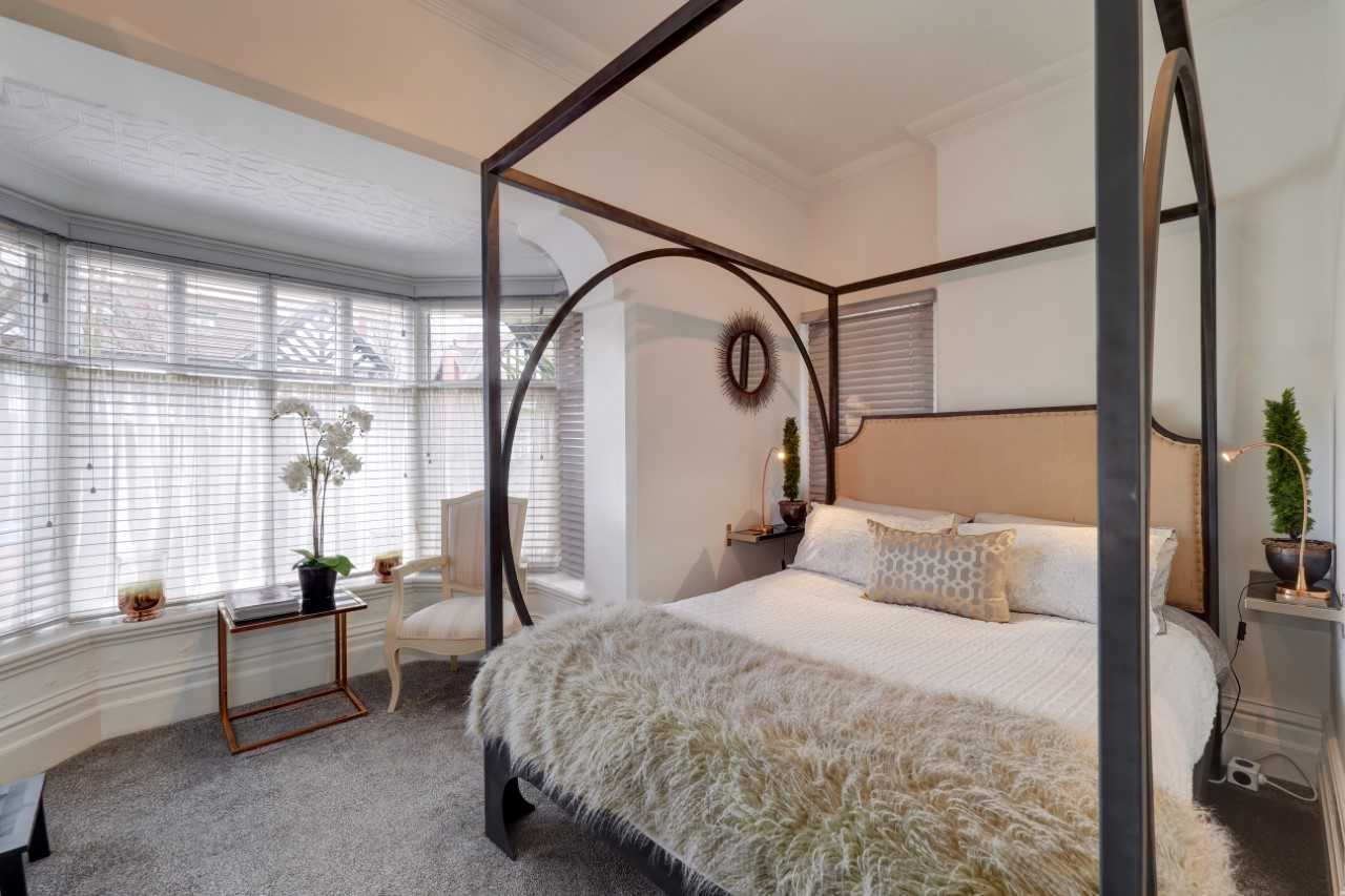 Charming bedroom at Mulberry House Apartments