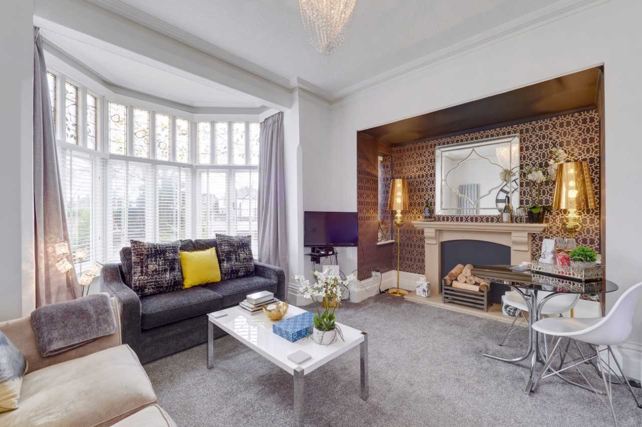Bright living room at Mulberry House Apartments