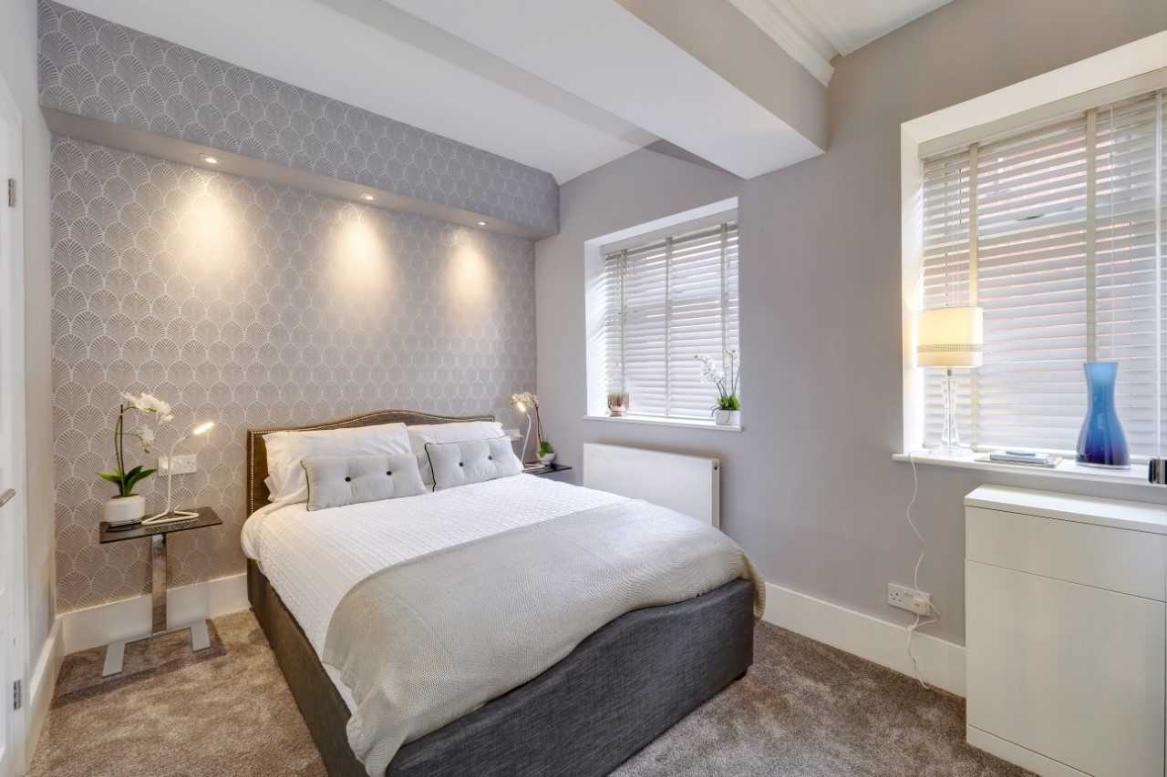Modern bedroom at Mulberry House Apartments