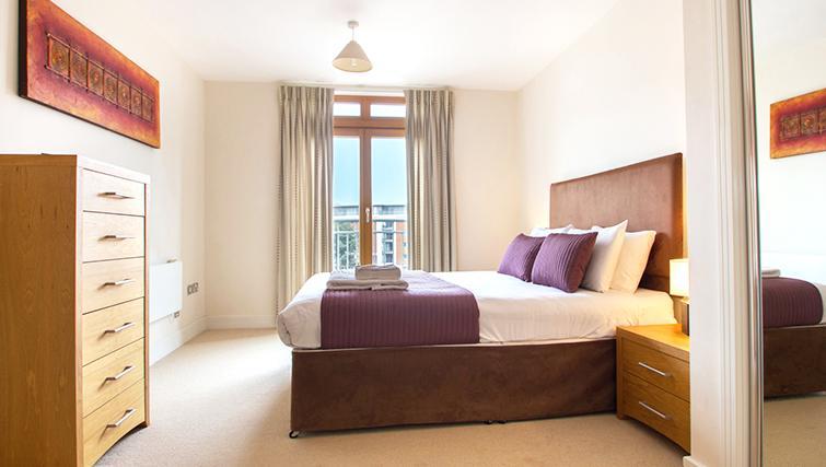 Spacious bedroom at The Post Box Apartments