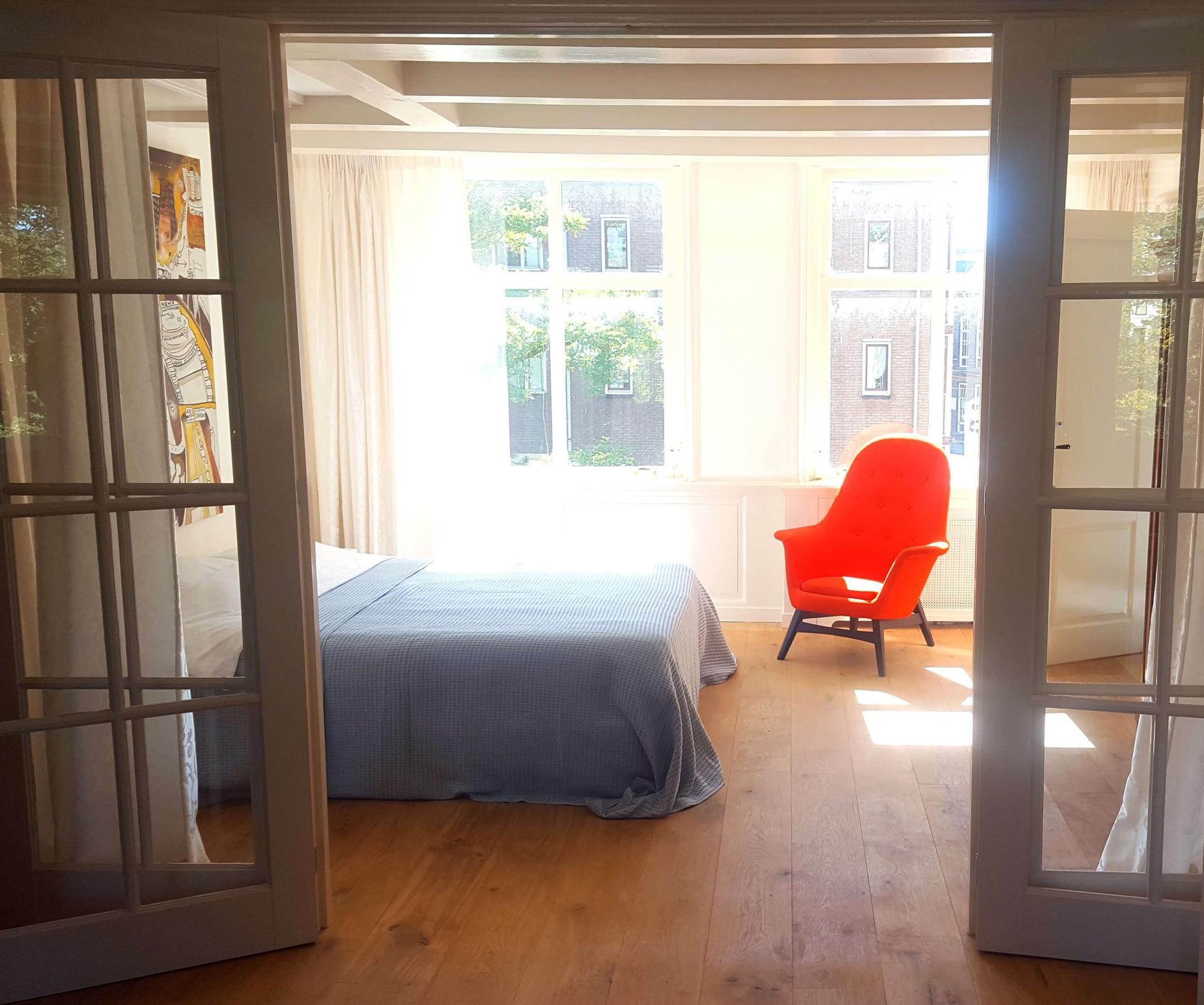 Bright bedroom at 23 Haarlemmplein Apartments, Amsterdam