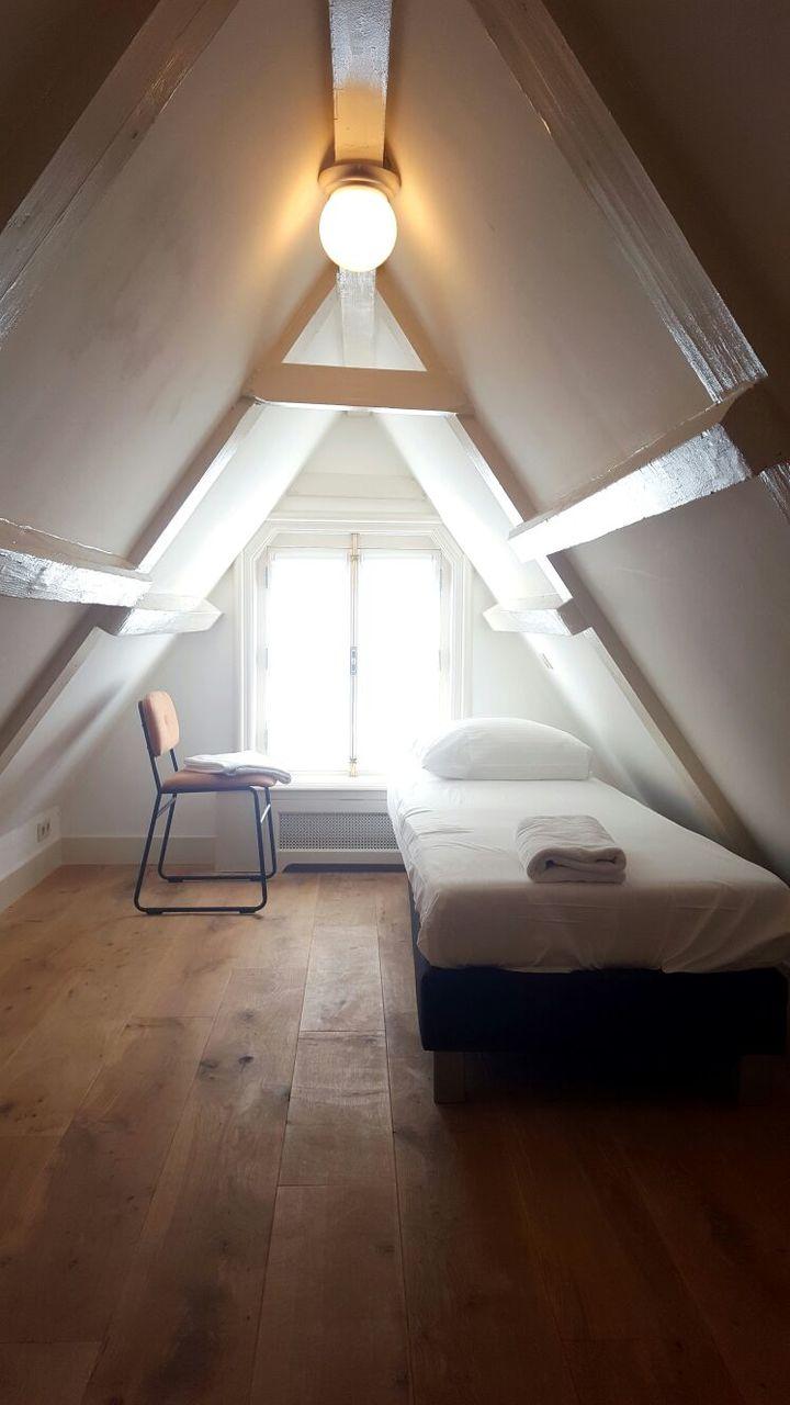 Loft room at 23 Haarlemmplein Apartments, Amsterdam