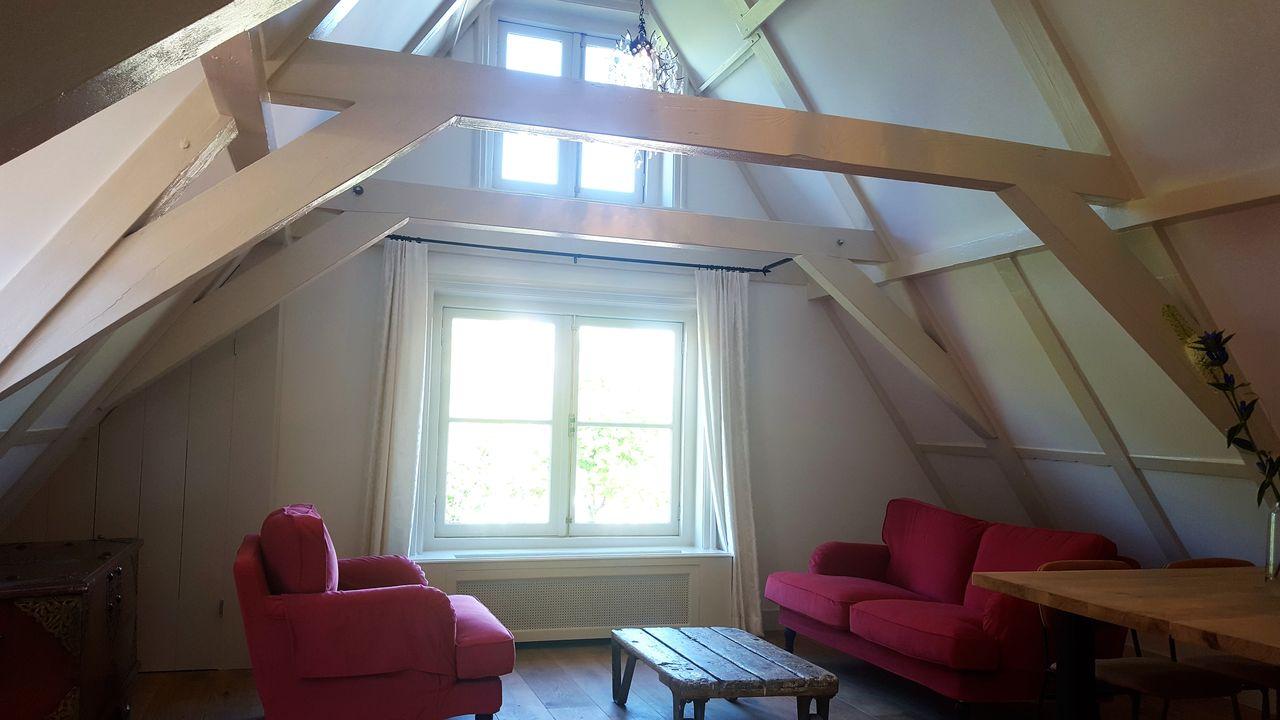 Loft living room at 23 Haarlemmplein Apartments, Amsterdam